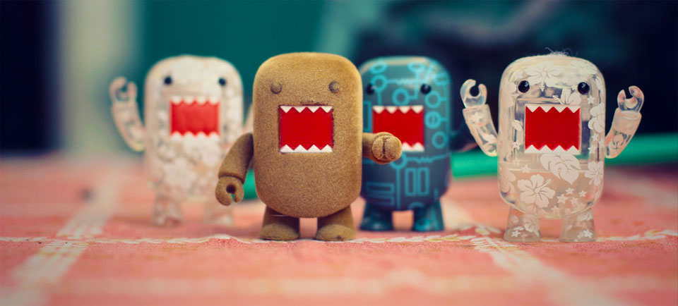 A photo of small toys with big mouths together and punching the air triumphantly.