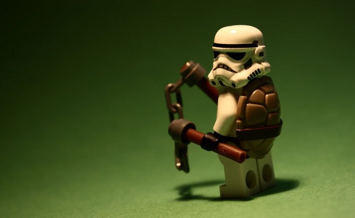 A photo of a Stormtrooper lego toy dressed in a Teenage Mutant Ninja Turtle outfit.
