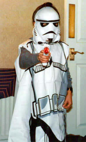 A young Sam Barnes dressed as a Stormtrooper from Star Wars