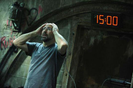 A movie screenshot of a game player holding his head in despair with a countdown time behind him