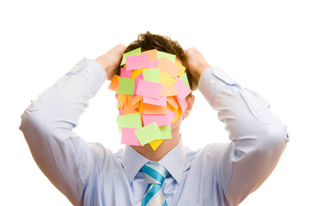A Web Project Manager who's face is covered in post-it notes