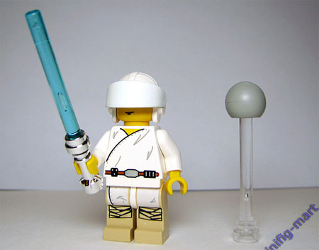 A picture of a Lego Star Wars Luke Skywalker figure in a mock-up of the lightsaber training scene