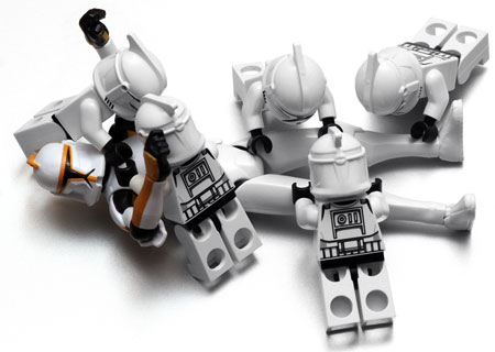 An image of several lego Star Wars characters beating up a lone one