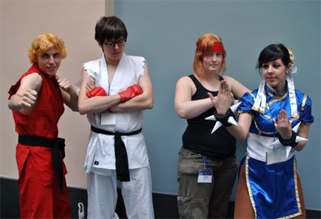 A group of nerdy looking kids dressed up in Street Fighter costumes