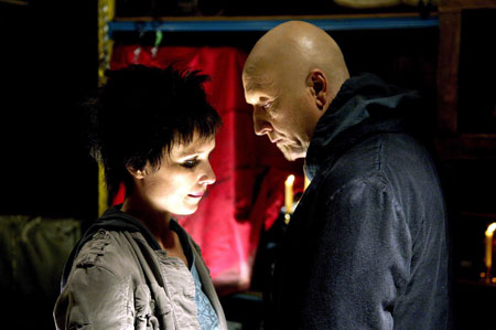 A movie screenshot of Jigsaw talking to Amanda in a dominating manner