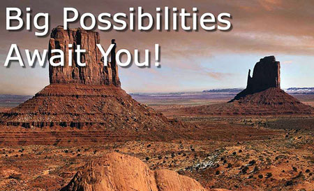 A photograph of a vast American desert landscape with huge mountains and boulders with super imposed words reading Big Possibilities Await You
